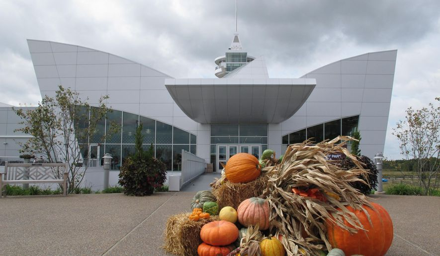 A bunch of Halloween pumpkins sits in front of the entrance to Discovery Park of America on Tuesday, Oct. 7, 2014 in Union City, Tenn. The museum, which opened last November in rural West Tennessee, has attracted more than 270,000 visitors in its first year. (AP Photo/Adrian Sainz).
