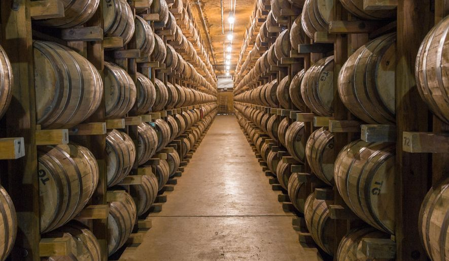 In this Aug. 14, 2014 photo, barrels of whiskey are stored at the George Dickel distillery near Tullahoma, Tenn. On Thursday, Oct. 30, 2014, state lawmakers renewed discussions about whether to change or rescind a state law that established requirements for distillers in order to label their product Tennessee whiskey. (AP Photo/Erik Schelzig)