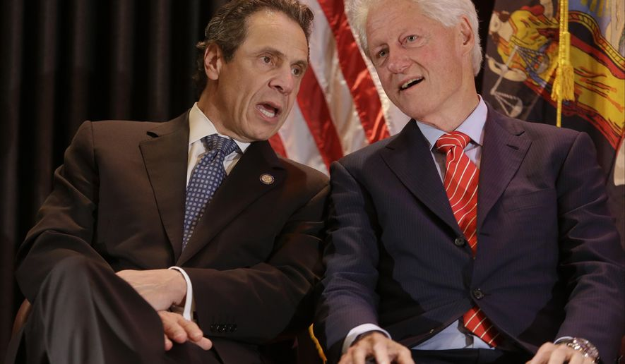 Former president Bill Clinton and New York Gov. Andrew M. Cuomo speak during a news conference as Lieutenant Governor Nominee Kathy Hochul looks on Thursday, Oct. 30, 2014, in New York. (AP Photo/Frank Franklin II)