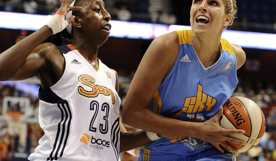 FILE - In this July 12, 2013, file photo, Chicago Sky's Elena Delle Donne, right, drives to the basket while guarded by Connecticut Sun's Allison Hightower during the first half of a WNBA basketball game in Uncasville, Conn. Delle Donne was brought to tears the more she read about Mount St. Joseph freshman Lauren Hill, who has inoperable brain cancer. (AP Photo/Jessica Hill, File)