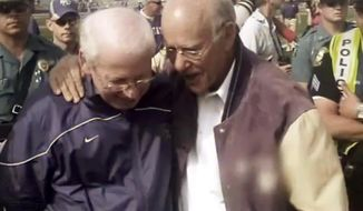In this image from his television ad provided by the Roberts campaign, Republican Kansas Sen. Pat Roberts, right, talks with Kansas State University football coach Bill Snyder. Roberts' campaign launched a statewide spot Thursday, Oct. 30, 2014 with Snyder endorsing the three-term incumbent just five days before the election, which has Roberts locked in a tough contest with independent candidate Greg Orman. (AP Photo/Pat Roberts Campaign)