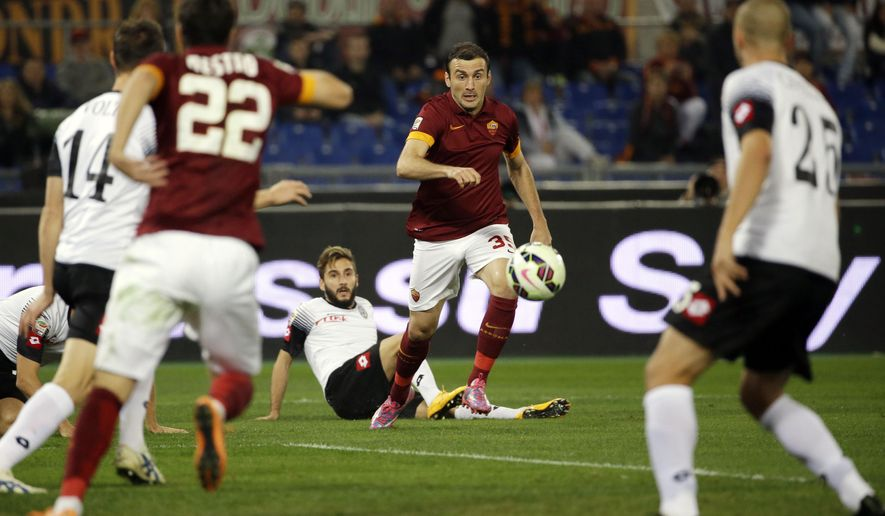 Roma's Vasilis Torosidis, center, controls the ball during the Serie A soccer match between Roma and Cesena at Rome's Olympic stadium, Wednesday, Oct. 29, 2014. (AP Photo/Gregorio Borgia)