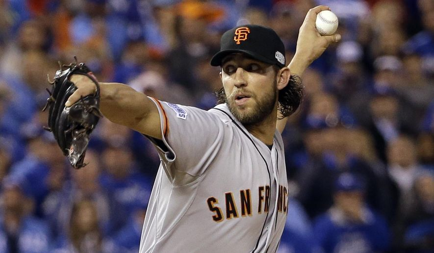 San Francisco Giants pitcher Madison Bumgarner throws during the fifth inning of Game 7 of baseball's World Series against the Kansas City Royals Wednesday, Oct. 29, 2014, in Kansas City, Mo. (AP Photo/David J. Phillip)