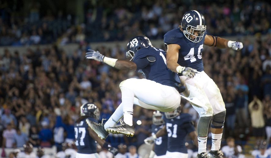 Ken Butler, left, and Edwin Jackson of Georgia Southern University celebrate Jackson's sack in the first half of an NCAA college football game, Thursday, Oct. 30, 2014 at Paulson Stadium in Statesboro, Ga. (AP Photo/Savannah Morning News, Brittney Lohmiller) THE EXAMINER.COM OUT; SFEXAMINER.COM OUT; WASHINGTONEXAMINER.COM OUT