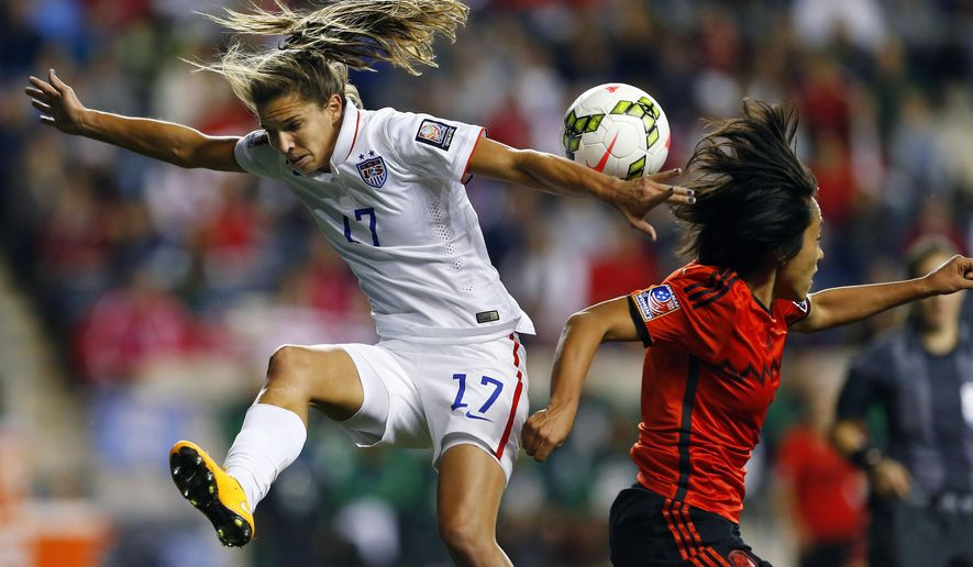10ThingstoSeeSports - United States midfielder Tobin Heath (17) heads the ball away from Mexico midfielder Liliana Mercado, right, in the first half during a CONCACAF semifinal soccer match in Chester, Pa., Friday, Oct. 24, 2014. (AP Photo/Rich Schultz, File)