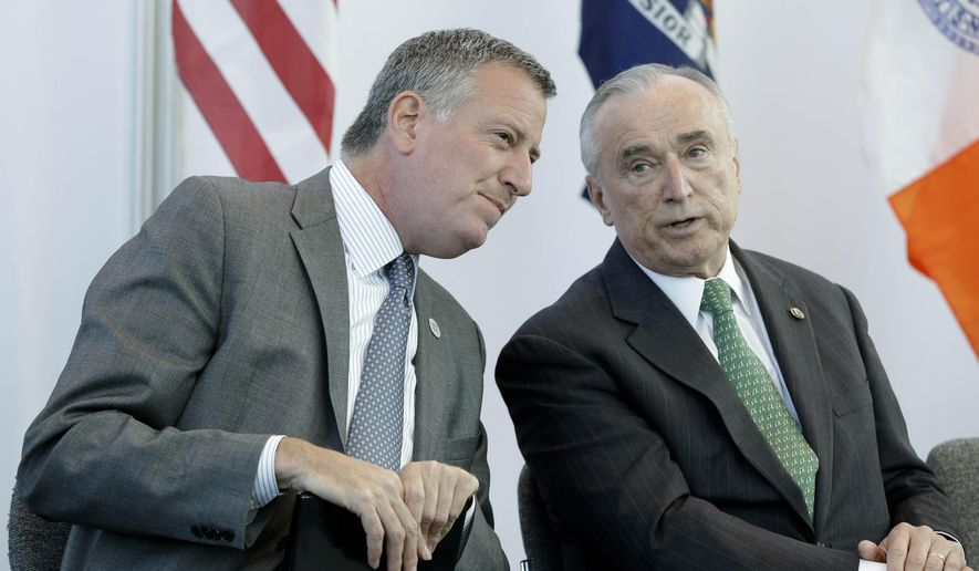 New York City mayor Bill de Blasio, left, and police commissioner Bill Bratton talk during a news conference in New York, Thursday, Oct. 30, 2014. The NYC Marathon will be run on Sunday, Nov. 2, 2014. (AP Photo/Seth Wenig)
