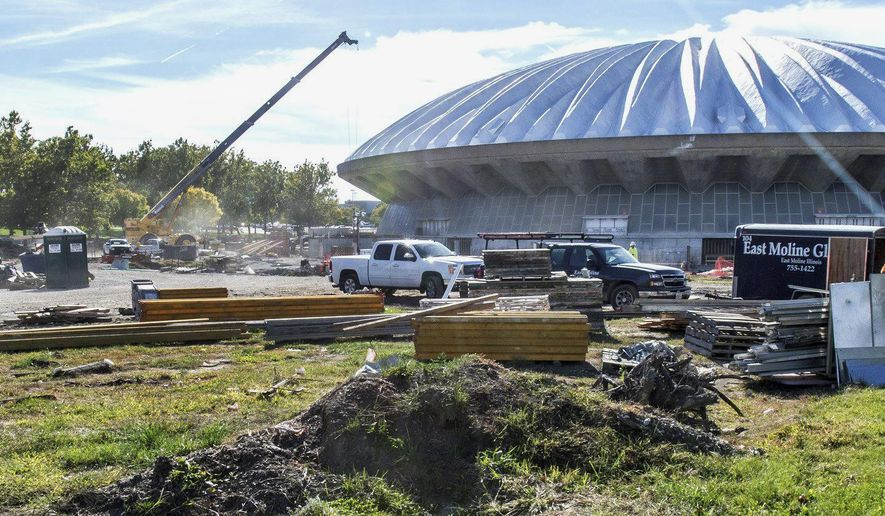 In this Sept. 24, 2014 photo, construction workers are seen outside the State Farm Center at the University of Illinois in Champaign, Ill., where a renovation project is taking place. The university said Thursday, Oct. 30, 2014, that the project will force the men's basketball team to play five games in November 2015 in Springfield, Ill. (AP Photo/The News-Gazette, Robin Scholz)  MANDATORY CREDIT