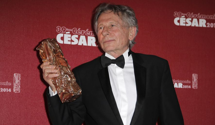 Polish-French film director Roman Polanski holds his best director award during the 39th French Cesar Awards Ceremony in Paris in this Feb. 28, 2014, file photo. (AP Photo/Lionel Cironneau, File)