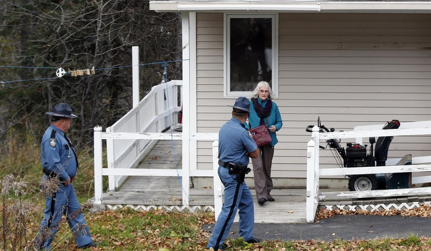 A worker from the Centers for Disease Control leaves the home of nurse Kaci Hickox after a brief visit, Thursday, Oct. 30, 2014, in Fort Kent, Maine. State officials are going to court to keep Hickox in quarantine for the remainder of the 21-day incubation period for Ebola that ends on Nov. 10. Police are monitoring her, but can't detain her without a court order signed by a judge. (AP Photo/Robert F. Bukaty)