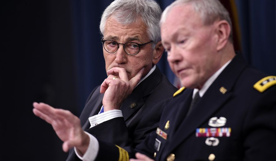 Defense Secretary Chuck Hagel listens at left as Joint Chiefs Chairman Gen. Martin E. Dempsey speaks during a briefing at the Pentagon, Thursday, Oct. 30, 2014. (AP Photo/Susan Walsh)