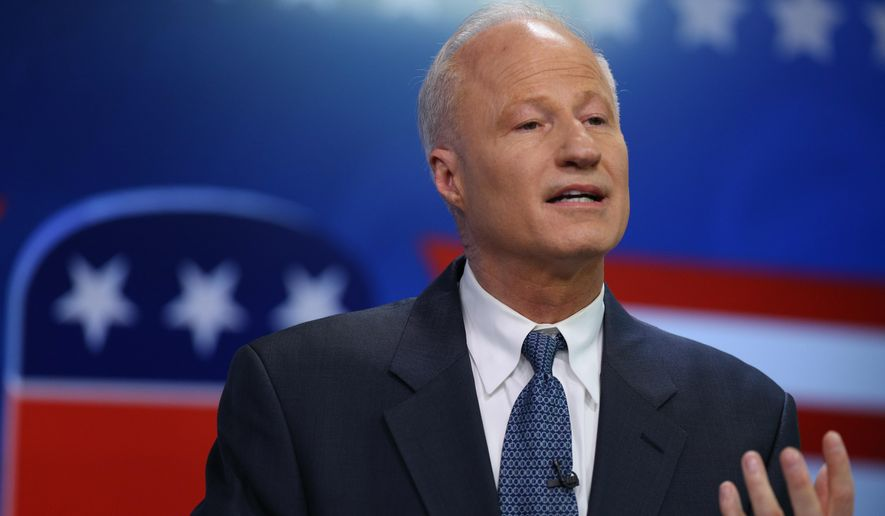 U.S. Rep. Mike Coffman, R-Colo., makes point while speaking in Spanish during debate with his Democratic challenger Andrew Romanoff in the studio of a television station in Denver on Thursday, Oct. 30, 2014. (AP Photo/David Zalubowski) ** FILE **
