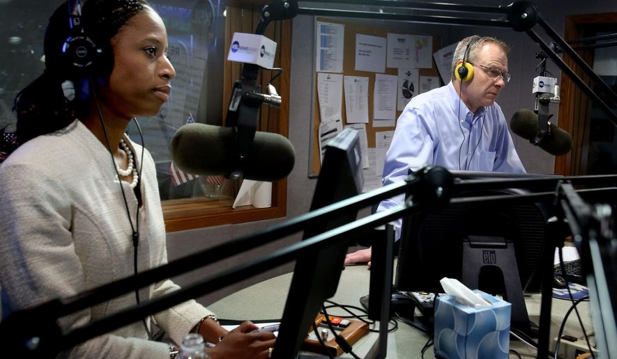 Utah 4th Congressional District candidates Republican Mia Love and  Democrat Doug Owens debate on the Doug Wright Show in Salt Lake City, Thursday, Oct. 30, 2014. (AP Photo/The Deseret News, Laura Seitz)
