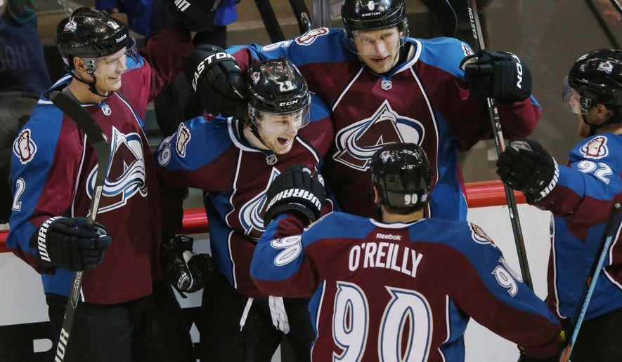 Clockwise from top left, Colorado Avalanche defenseman Nick Holden celebrates with center Nathan MacKinnon after his goal against the New York Islanders with defenseman Erik Johnson, left wing Gabriel Landeskog, of Sweden, and center Ryan O'Reilly in the second period of an NHL hockey game in Denver on Thursday, Oct. 30, 2014. (AP Photo/David Zalubowski)