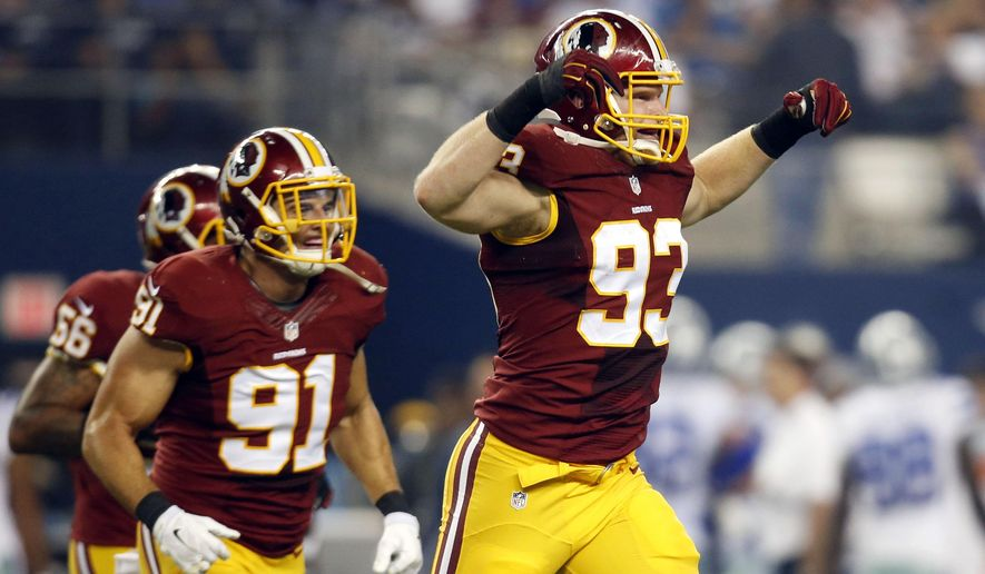 Washington Redskins' Ryan Kerrigan (91) watches as linebacker Trent Murphy (93) celebrates recovering a Dallas Cowboys' Joseph Randle fumble during the first half of an NFL football game, Monday, Oct. 27, 2014, in Arlington, Texas. (AP Photo/Tim Sharp)