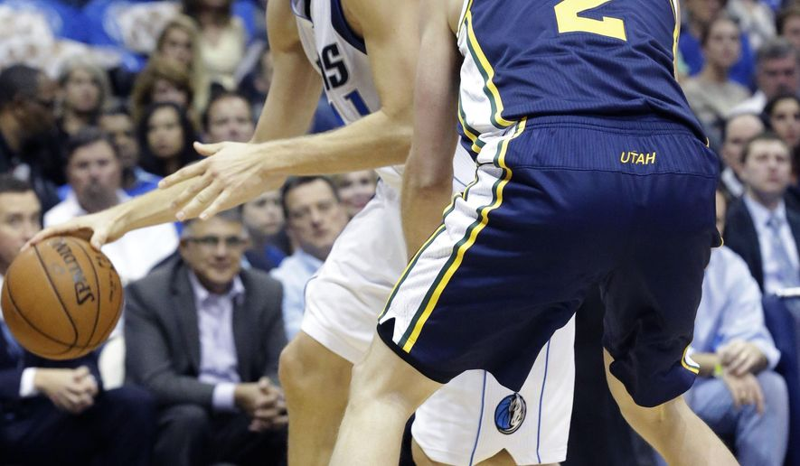 Dallas Mavericks forward Dirk Nowitzki, left, of Germany, drives against Utah Jazz forward Joe Ingles (2) during the first half of an NBA basketball game, Thursday, Oct. 30, 2014, in Dallas. (AP Photo/LM Otero)