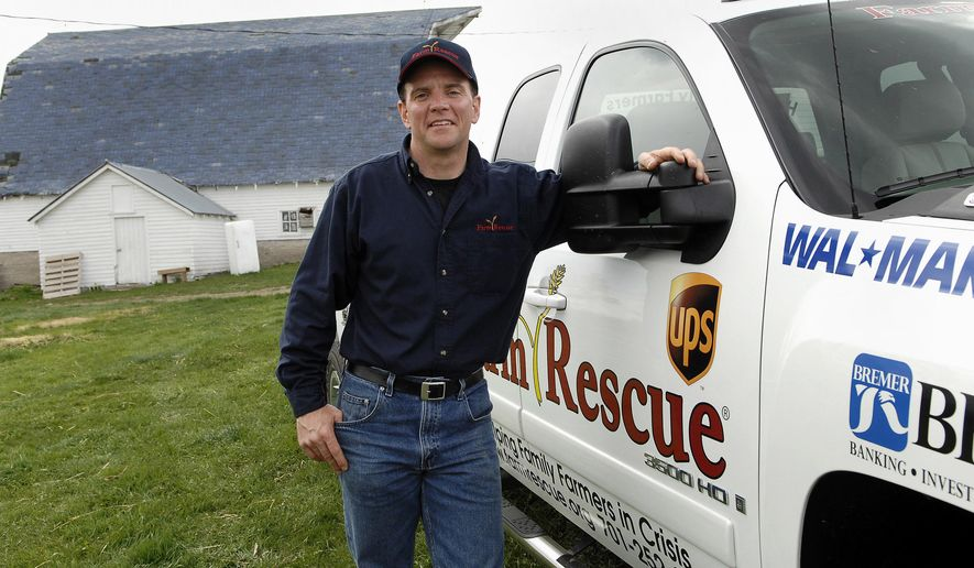FILE - In this May 8, 2008 file photo, Farm Rescue founder Bill Gross poses at the Strand farm in Nome, N.D. The Farm Rescue nonprofit in the Midwest is helping its 300th family this week, just eight years after Gross, a former North Dakota farm boy and UPS pilot, launched the unique organization. A handful of volunteers are helping harvest corn for western Minnesota farmer John Dubbels, who's being treated for blood cancer. Farm Rescue plants and harvests crops for farmers in the Dakotas, Minnesota, Iowa and eastern Montana. (AP Photo/Will Kincaid, File)