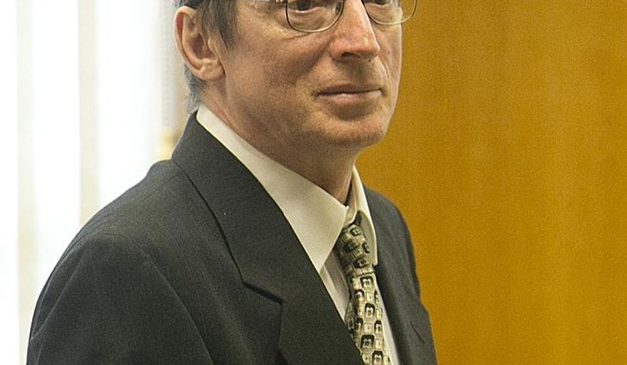 FILE - In this Monday, Oct. 20, 2014 file photo, Joseph Reinwand looks on before the first day of his homicide trial at Wood County Courthouse in Wisconsin Rapids, Wisc. The attorneys for Reinwan, accused of killing his daughter's ex-boyfriend, have rested their case after two days of witness testimony. (AP Photo/The Marshfield News-Herald, Megan McCormick, file)