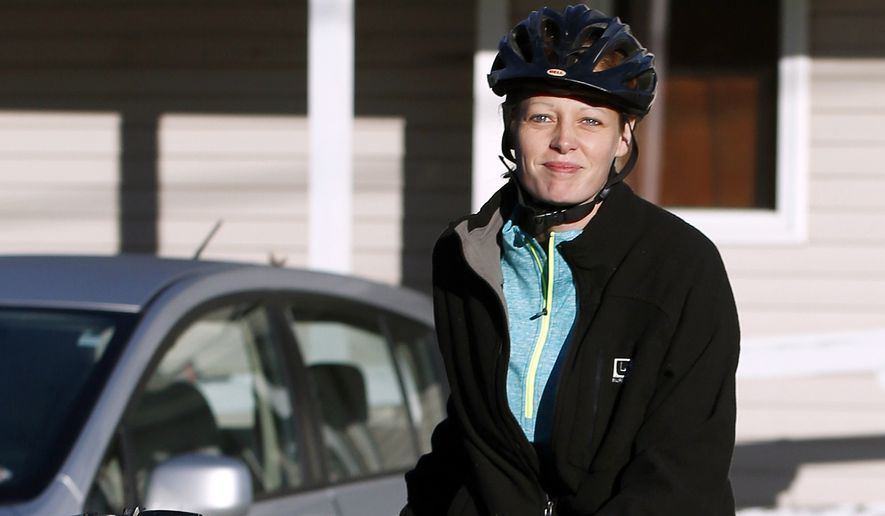 Nurse Kaci Hickox leaves her home on a rural road in Fort Kent, Maine, to take a bike ride with her boyfriend Ted Wilbur, Thursday, Oct. 30, 2014.  The couple went on an hour-long ride followed by a Maine State Trooper.  State officials are going to court to keep Hickox in quarantine for the remainder of the 21-day incubation period for Ebola that ends on Nov. 10. Police are monitoring her, but can't detain her without a court order signed by a judge. (AP Photo/Robert F. Bukaty)
