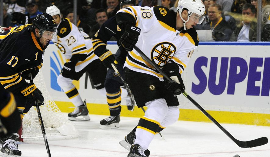 Buffalo Sabres' Torrey Mitchell (17) pursues Boston Bruins' Reilly Smith (18) during the second period of an NHL hockey game Thursday, Oct., 30, 2014, in Buffalo, N.Y. (AP Photo/Gary Wiepert)