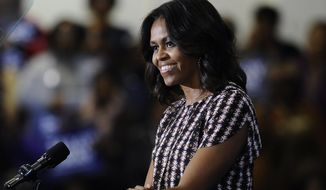 First lady Michelle Obama speaks to supporters during a rally for Connecticut Gov. Dannel P. Malloy Thursday, Oct. 30, 2014, in New Haven, Conn. (AP Photo/Jessica Hill)
