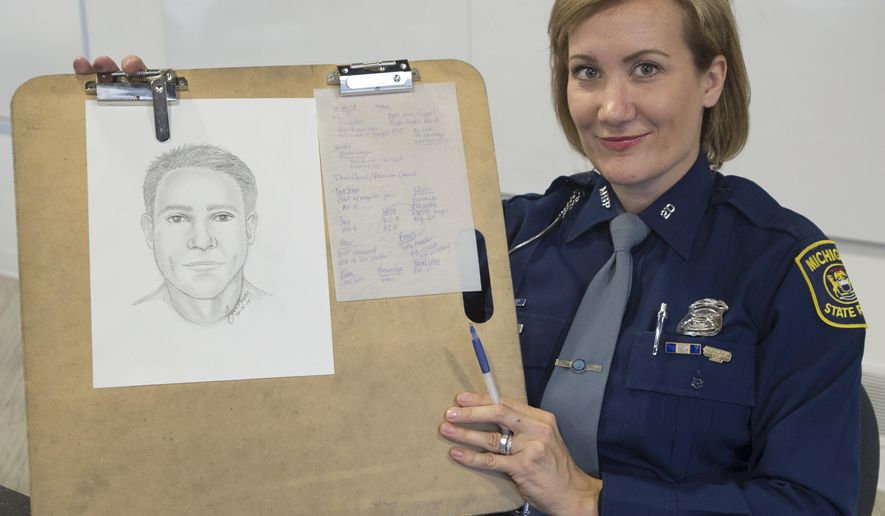 """Michigan State Police sketch artist Detective Trooper Sarah Krebs holds up the final version of a """"suspect's"""" composite she drew, Oct. 14, 2014. Saginaw News reporter Brad Devereaux described reporting intern R.J. Wolcott to Krebs so she could demonstrate how she draws a composite from a crime victim's description.  (AP Photo/The Saginaw News, Jeff Schrier)"""
