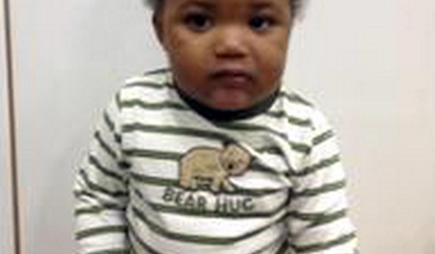 This image provided by the Long Beach, Calif., Police Department shows one of two young children found wandering the streets of Long Beach Thursday morning, Oct. 30, 2014. Long Beach police were called to Atlantic Avenue and 60th Street after a passer-by saw two small children that were alone shortly before 9 a.m. The children, both African-American boys, are approximately one and two years of age, and appear to be in good health. The older child was found wearing a t-shirt, shorts and sandals, and the younger child was wearing a t-shirt and diaper. (AP Photo/Long Beach Police Department)