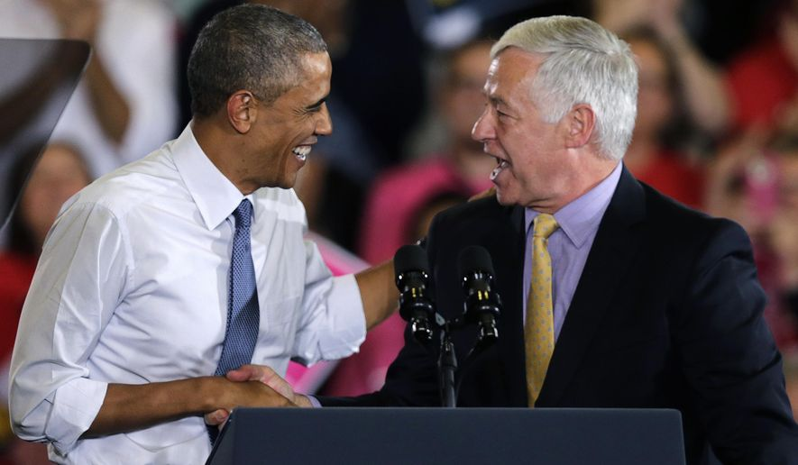 President Barack Obama shakes hands with U.S. Rep. Mike Michaud, the Maine Democratic gubernatorial candidate, during a campaign rally in Portland, Maine, Thursday, Oct. 30, 2014. Michaud faces Republican Gov. Paul LePage and Independent Eliot Cutler in the Nov. 4, general election. (AP Photo/Charles Krupa)