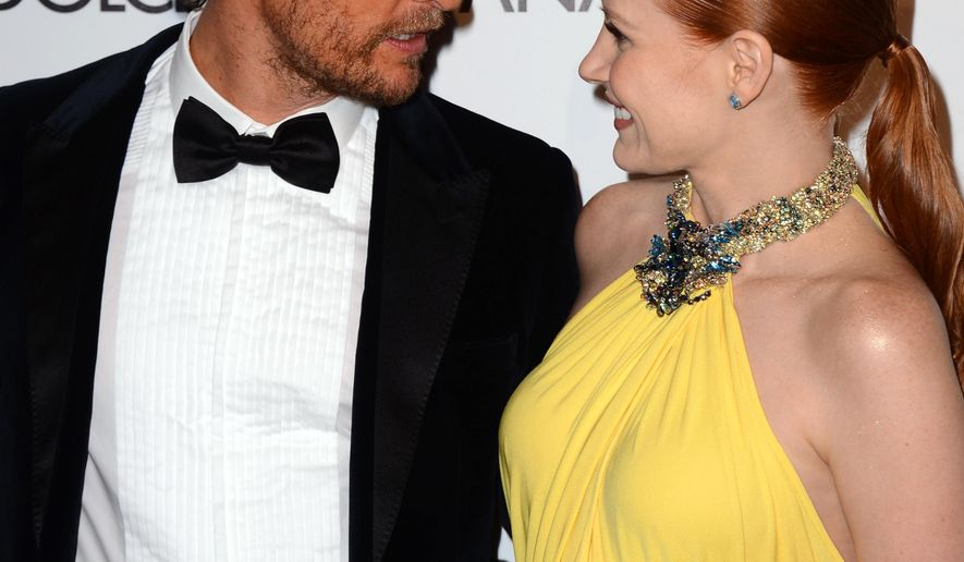 "FILE - In this Tuesday, Oct. 21, 2014 file photo, honoree actor Matthew McConaughey, left, and actress Jessica Chastain arrive at the 28th annual American Cinematheque award ceremony honoring McConaughey at the Beverly Hilton Hotel, in Beverly Hills, Calif. While only a 7-year age difference separates McConaughey and Chastain in the real world, the theory of relativity finds them playing a disconnected father and daughter in the film ""Interstellar,"" writer-director Christopher Nolan's space-time saga, scheduled for release Nov. 5, 2014, about a last-ditch effort to find humans a new home.  (Photo by Jordan Strauss/Invision/AP, File)"