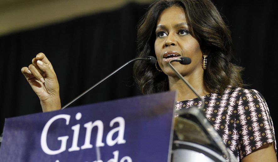 First lady Michelle Obama campaigns for Rhode Island Democratic gubernatorial candidate Gina Raimondo, Thursday, Oct. 30, 2014, during a Raimondo campaign event at the Juanita Sanchez Educational Complex in Providence, R.I. (AP Photo/Stew Milne)