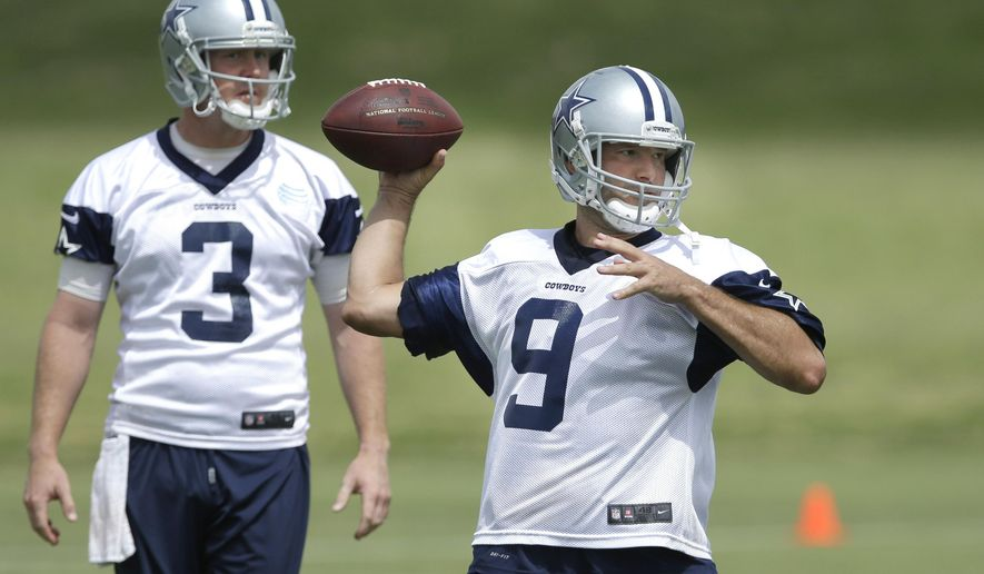 """FILE - In this June 18, 2014, file photo, Dallas Cowboys quarterback Tony Romo (9) passes as back-up quarterback Brandon Weeden (3) looks on during an NFL football minicamp in Irving, Texas. Weeden had led scoring drives on the only two possessions Romo missed against Washington when the Dallas starter tapped his backup on the shoulder and said, """"Hey man, hell of a job. I'm going back in.""""(AP Photo/LM Otero, File)"""
