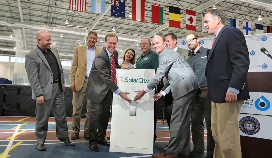 "Salt Lake County Mayor Ben McAdams, left, and State of Utah Lt. Governor Spencer Cox turn on the ""Lighting Ceremony"" celebrating the solar array project of panels built on top of the parking cover outside of the Utah Olympic Oval with creates enough power to take over 500 homes off the power grid Thursday, Oct. 30, 2014, in Kearns.  (AP Photo/The Deseret News, Tom Smart, Deseret News)"