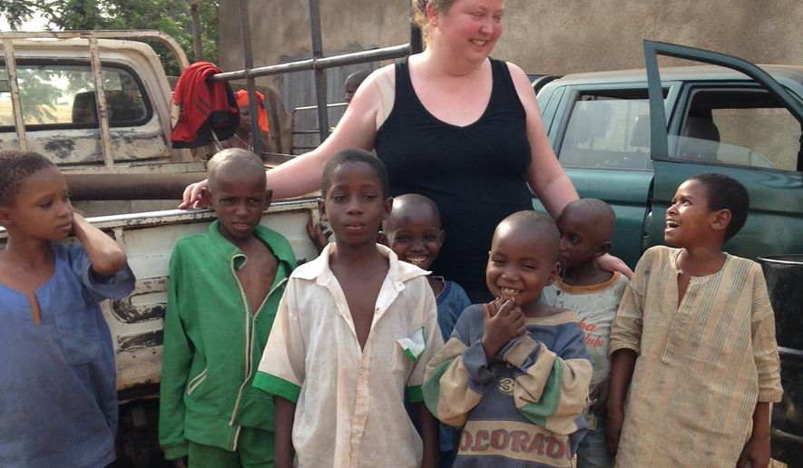 Krista Larson chats with orphans she interviewed at a Catholic church sheltering more than 800 Muslims in Carnot, Central African Republic who had fled sectarian violence earlier this year. Krista Larson, who has covered the Ebola outbreak and the deadly conflict in Central African Republic for The Associated Press, has been named bureau chief for West Africa for the news cooperative. The appointment was announced Thursday by AP Africa Editor Andrew Selsky. (AP Photo/Steve Niko)