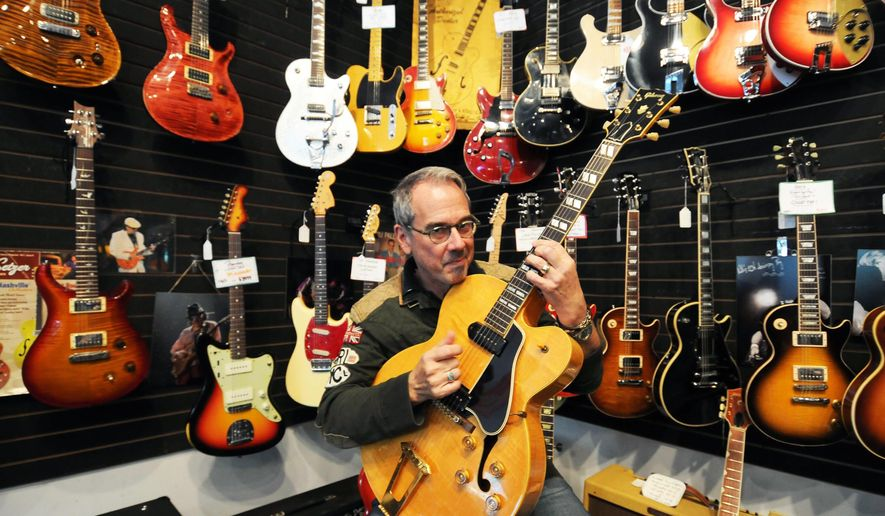 ADVANCE FOR USE MONDAY, NOV. 3 - In this photo taken on Oct. 9, 2014, Nate Westgor, owner of Willie's American Guitars, holds the guitar made famous by American singer/songwriter Chuck Berry, a '53 Gibson ES 350, at Westgor's shop in St. Paul, Minn. Westgor doesn't get star-struck when these  walk into his shop. He sees them instead just as fellow guitar nuts. His customers aren't all Grammy winners, though. Many are passionate amateurs; some are collectors who don't even play.  (AP Photo/The St. Paul Pioneer Press, Scott Takushi) )  MINNEAPOLIS STAR TRIBUNE OUT, MAGS OUT