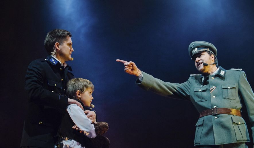 In this photo dated Oct. 11, 2014, made available Thursday Oct. 30, 2014, from musical production company, actors perform a scene during a musical play depicting the famous Latvian aviation pioneer Herbert Cukurs, who notoriously joined a Nazi killing squad during World War II, and is being brought to life in a stage musical in Liepaja, Latvia, that has outraged Jews in the Baltic country and beyond. Producer Juris Millers says that because Cukurs never went on trial it remains unclear to what extent he participated in atrocities committed by the notorious Arajs Commando, which is blamed for murdering 30,000 people, mostly Jews, during the 1941-1944 Nazi occupation of Latvia. (AP Photo/Raimonds Birkenfields) NO ARCHIVING - NO LICENSING
