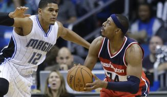 Washington Wizards' Paul Pierce (34) looks to shoot as he is guarded by Orlando Magic's Tobias Harris (12) during the second half of an NBA basketball game in Orlando, Fla., Thursday, Oct. 30, 2014. Washington won 105-98. (AP Photo/John Raoux)