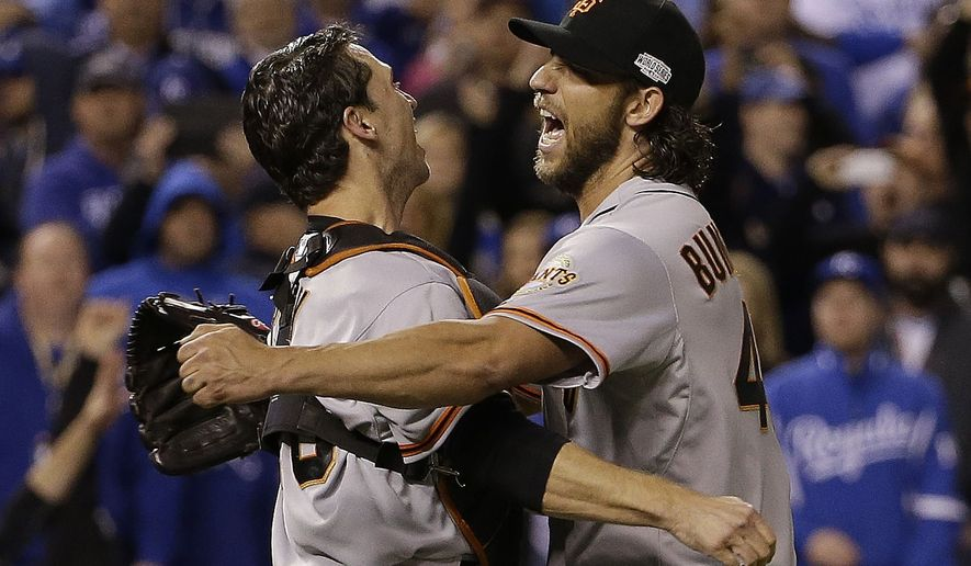 San Francisco Giants' Madison Bumgarner and catcher Buster Posey celebrate after Game 7 of baseball's World Series against the Kansas City Royals Wednesday, Oct. 29, 2014, in Kansas City, Mo. The Giants won 3-2 to win the series.  (AP Photo/David J. Phillip)