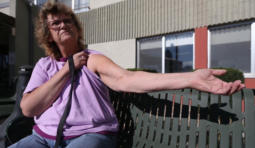 In this Thursday, Oct. 30, 2014 photo, Ora Tigner, a resident at Royal View Manor in Des Moines, Iowa shows off her arms which she claims have been bitten by bedbugs in addition to her legs and torso. A class-action lawsuit accuses the city of Des Moines of not properly handling an extended bedbug infestation at the Royal View Manor, a housing complex for low-income elderly and disabled people. (AP Photo/The Des Moines Register, Bryon Houlgrave)