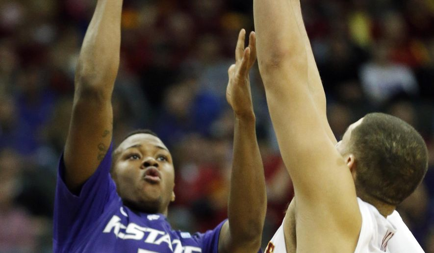 FILE - In this March 13, 2014, file photo, Kansas State guard Marcus Foster (2) shoots over Iowa State forward Georges Niang during the first half of an NCAA college basketball game in the quarterfinals of the Big 12 Conference tournament in Kansas City, Mo. Marcus Foster and Thomas Gipson shouldn't have to shoulder nearly the load for Kansas State this season. Three newcomers with Division I experience should provide coach Bruce Weber the most depth he's had in three seasons leading the Wildcats. (AP Photo/Orlin Wagner, File)