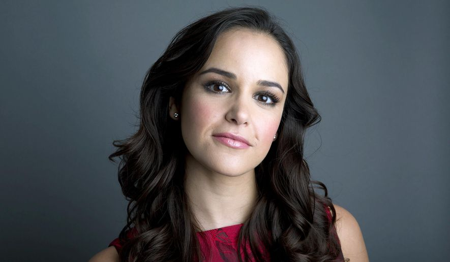 """In this Oct. 22, 2014 photo, actress Melissa Fumero poses in New York to promote her Fox comedy series """"Brooklyn Nine Nine."""" (Photo by Amy Sussman/Invision/AP)"""