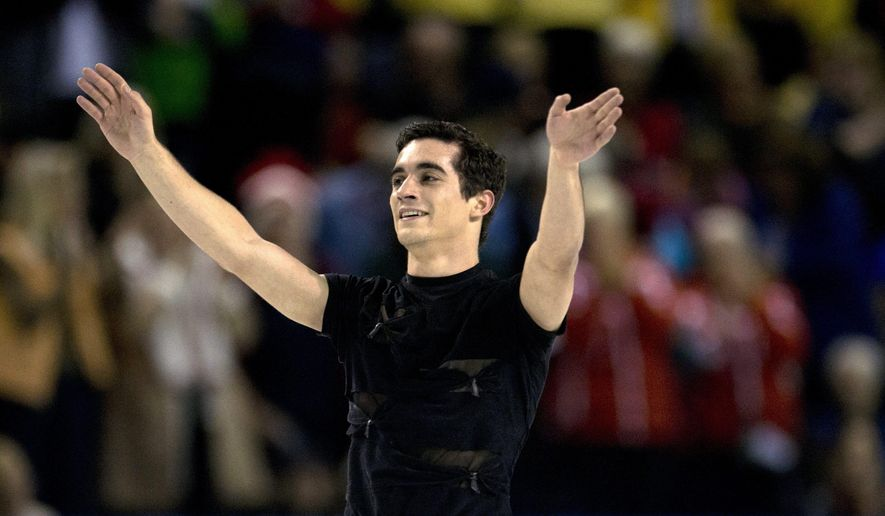 Javier Fernandez, of Spain, waves to the crowd following his performance during the men's short program of the Skate Canada figure skating event in Kelowna, British Columbia, Friday, Oct. 31, 2014. (AP Photo/The Canadian Press, Jonathan Hayward)