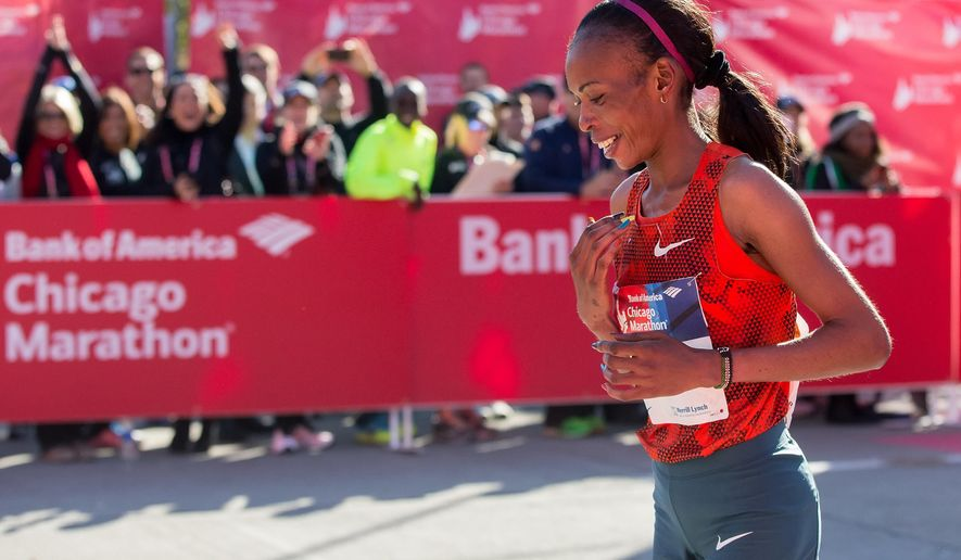 FILE - In this Sunday, Oct. 12, 2014 file photo, Rita Jeptoo of Kenya reacts after crossing the finish line to win the women's race during the Chicago Marathon, in Chicago, Illinois. The agent for Chicago Marathon champion Rita Jeptoo said Friday, Oct. 31, 2014 that the Kenyan runner has failed a doping test. (AP Photo/Andrew A. Nelles, File)