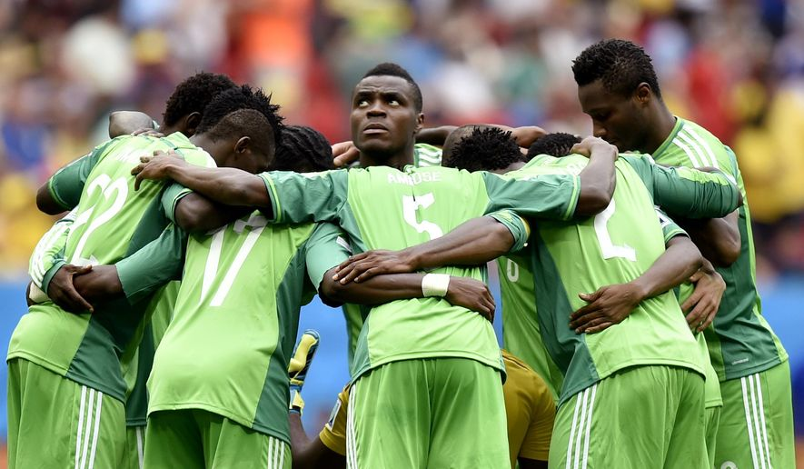 "File: In this Monday, June 30, 2014 file photo, Nigeria's Emmanuel Emenike, center, looks up as his team form a huddle before the start of the second half during the World Cup round of 16 soccer match between France and Nigeria at the Estadio Nacional in Brasilia, Brazil. FIFA says it is giving Nigeria one last chance to avoid a ""lengthy"" ban, by demanding that the government stops interfering in NFF Nigeria Football Federation business. The threatened ban would prevent the reigning champions from defending its title at next year's Africa Cup of Nations.(AP Photo/Martin Meissner, FILE)"