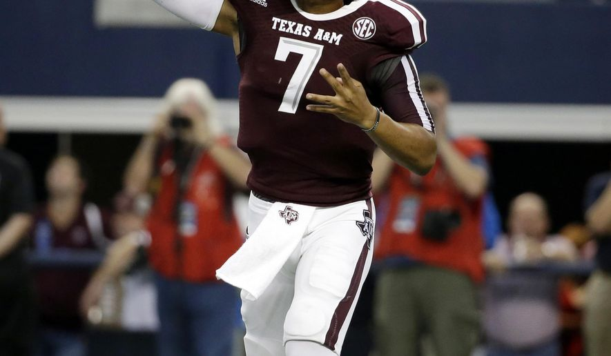 FILE - This Sept. 27, 2014, file photo, shows Texas A&M quarterback Kenny Hill passing in the first half of an NCAA college football game against Arkansas in Arlington, Texas. Kenny Hill may be headed for the bench. Offensive coordinator Jake Spavital said Tuesday, Oct. 28, 2014,  that Hill and freshman Kyle Allen have been taking snaps with the first team this week and a starter for Saturday's, Nov. 1, 2014,  game against Louisiana-Monroe will be decided later this week. (AP Photo/Tony Gutierrez, File)