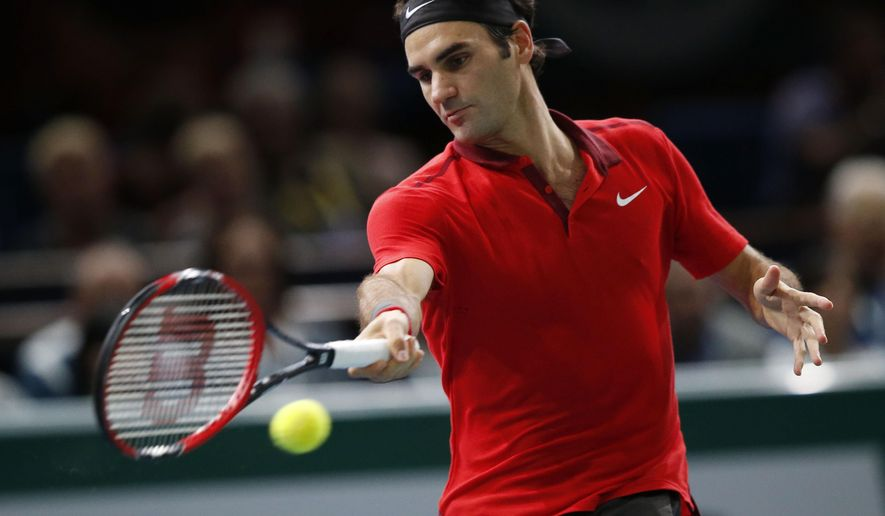 Roger Federer of Switzerland returns the ball to Milos Raonic of Canada during their quarterfinal match at the ATP World Tour Masters tennis tournament at Bercy stadium in Paris, France, Friday, Oct. 31, 2014. Raonic won 7-6, 7-5.  (AP Photo/Michel Euler)