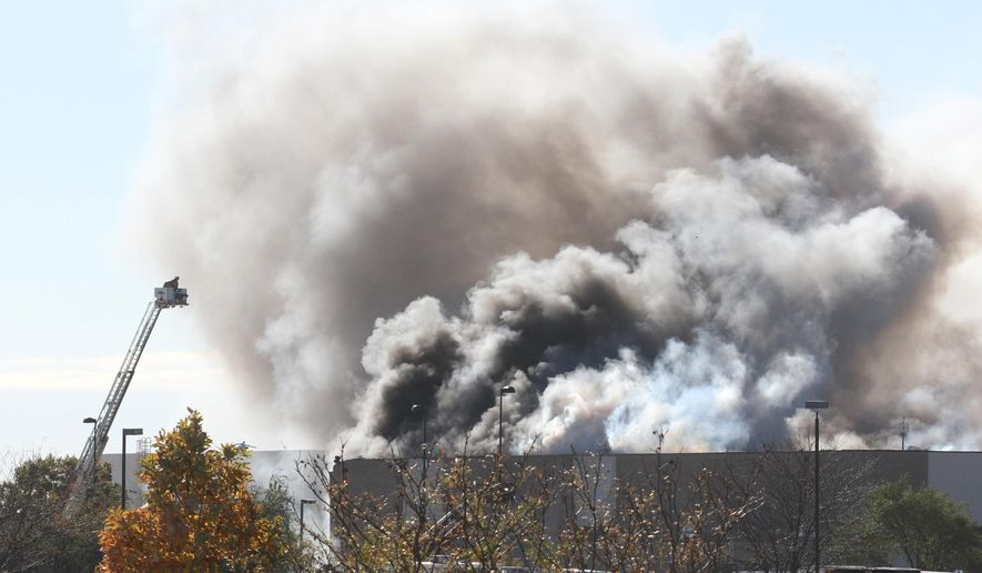 Smoke billows from a building at Mid-Continent Airport in Wichita, Kan., Thursday. Oct. 30, 2014, shortly after a small plane crashed into the building killing several people including the pilot. (AP Photo/The Wichita Eagle, Brian Corn) LOCAL TELEVISION OUT; MAGS OUT; LOCAL RADIO OUT; LOCAL INTERNET OUT
