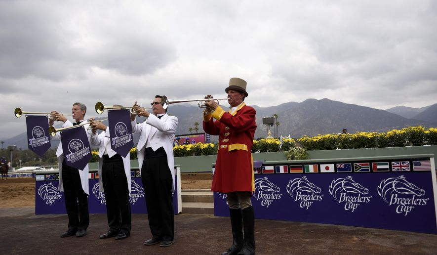 Buglers warm up before the start of the Breeders Cup horse races Friday, Oct. 31, 2014 at Santa Anita Park  in Arcadia, Calif. (AP Photo/Jae C. Hong)