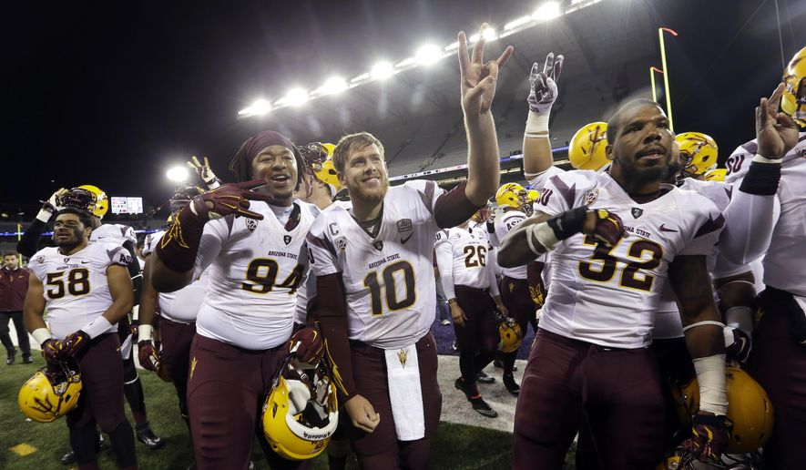 Arizona State quarterback Taylor Kelly (10) and teammates celebrate after beating Washington in an NCAA college football game Saturday, Oct. 25, 2014, in Seattle. Arizona State won 24-10. (AP Photo/Elaine Thompson)