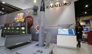 A model of Israeli weapon company Rafael' C-Dome is presented at the Euronaval show, in Le Bourget, north of Paris, Thursday, Oct. 30, 2014. Israel's state-owned defense contractor Rafael wants to leverage the system's much-vaunted success in protecting Israeli civilians in this summer's Gaza war, hoping to draw navies as buyers for a new maritime version seen as especially useful in protecting national economic resources at sea like oil and gas platforms. (AP Photo/Christophe Ena)