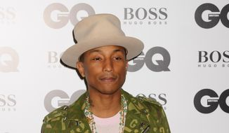 Pharrell Williams arrives for the GQ Men Of The Year Awards 2014 at a central London venue, London, in this Sept. 2, 2014, file photo. (Photo by Jonathan Short/Invision/AP, File)