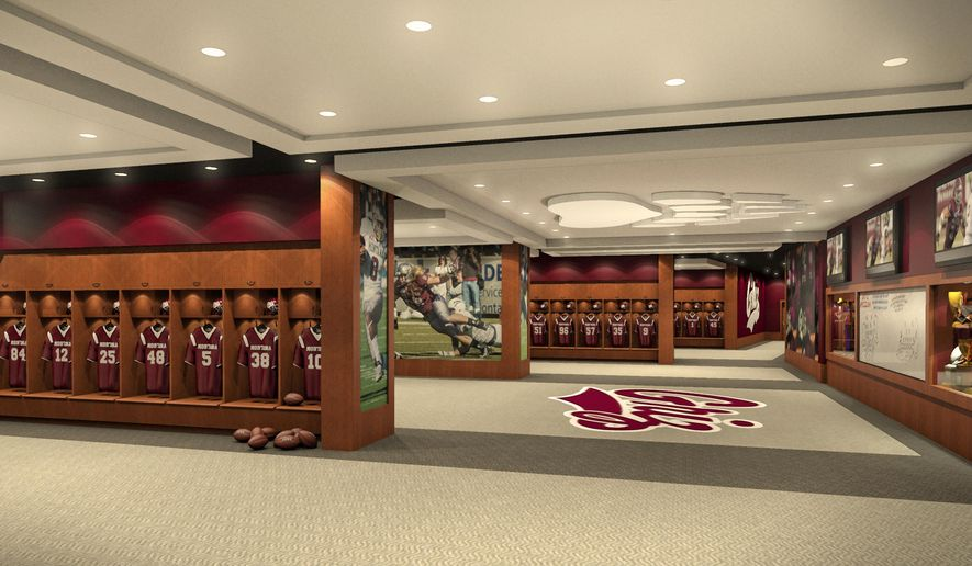 This undated architect rendering provided by the University of Montana shows the new locker room planned for the University of Montana football team. The university announced Friday that the Dennis and Phyllis Washington Foundation donated $7 million toward the planned $14 million Washington-Grizzly Champions Center which would also include a two-level weight room open to all of the university's 15 athletic teams. (AP Photo/University of Montana)